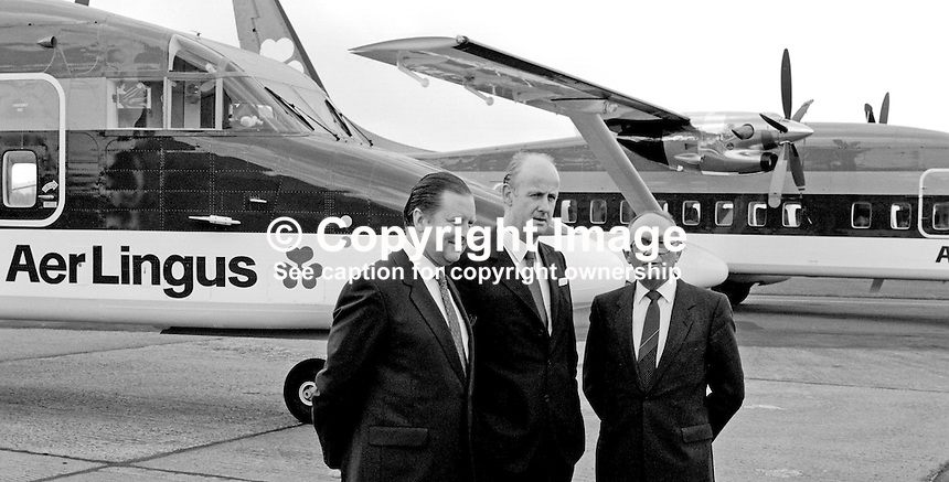David Kennedy, chief executive, Aer Lingus, centre, with Alex Roberts, marketing director, left, and Dennis Head, operations director, right, of Short Brothers plc, Belfast, N Ireland, on the occasion, 7th March 1984, when Aer Lingus took delivery of two Shorts SD360 aircraft. 19840032AR+DK+DH1.<br /> <br /> Copyright Image from Victor Patterson, 54 Dorchester Park, <br /> Belfast, UK, BT9 6RJ<br /> <br /> t1: +44 28 9066 1296 (from Rep of Ireland 048 9066 1296)<br /> t2: +44 28 9002 2446 (from Rep of Ireland 048 9002 2446)<br /> m: +44 7802 353836<br /> <br /> e1: victorpatterson@me.com<br /> e2: victorpatterson@gmail.com<br /> <br /> www.victorpatterson.com<br /> <br /> Please see my Terms and Conditions of Use at www.victorpatterson.com. It is IMPORTANT that you familiarise yourself with them.<br /> <br /> Images used on the Internet must be visibly watermarked i.e. &copy; Victor Patterson within the body of the image and copyright metadata must not be deleted. Images used on the Internet have a size restriction of 4kbs and will be chargeable at current NUJ rates unless advised otherwise.<br /> <br /> This image is only available for the use of the download recipient i.e. television station, newspaper, magazine, book publisher, etc, and must not be passed on to any third party. It is also downloaded on condition that each and every usage is notified within 7 days to victorpatterson@me.com<br /> <br /> The right of Victor Patterson to be identified as the author is asserted in accordance with The Copyright Designs And Patents Act (1988).