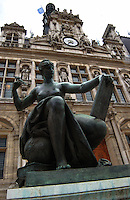 Metal green statue of woman outside Hotel de Ville the town hall of Paris.