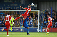Cameron Burgess of Scunthorpe United haads the ball above Kwesi Appiah of AFC Wimbledon during AFC Wimbledon vs Scunthorpe United, Sky Bet EFL League 1 Football at the Cherry Red Records Stadium on 15th September 2018