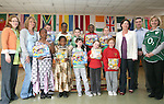 Winners from each class, Chloe, Ryan, Hilary, Nicole, Aimee, Iyanu, Aderonke, Jake and Zoe with Caoimhe Minigue, Dympna McKenna, Principal, Denise Sullivan and Karen Rooney fron the Parents Council and Hugh Doogan from Louth Leader Partnership at the Awards Ceremony for Intercultural and Anti-Racism Week in St. John's NS Rathmullen...Photo NEWSFILE/Jenny Matthews.(Photo credit should read Jenny Matthews/NEWSFILE)....This Picture has been sent you under the condtions enclosed by:.Newsfile Ltd..The Studio,.Millmount Abbey,.Drogheda,.Co Meath..Ireland..Tel: +353(0)41-9871240.Fax: +353(0)41-9871260.GSM: +353(0)86-2500958.email: pictures@newsfile.ie.www.newsfile.ie.FTP: 193.120.102.198.