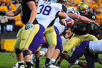 18 October 08: Colorado placekicker Aric Goodman (13) is hit on a play by  Kansas State defensive end Ian Campbell (98). His field goal attempt was blocked on the play and Kansas State gained possession of the loose ball. The Colorado Buffaloes defeated the Kansas State Wildcats 14-13 at Folsom Field in Boulder, Colorado.