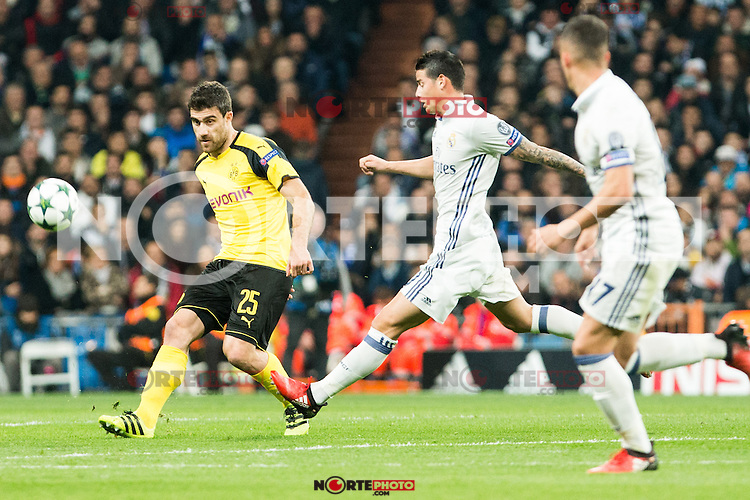 Borussia Dortmund Sokratis Papastathoppulos, Real Madrid's James Rodriguez  during Champions League match between Real Madrid and Borussia Dortmund  at Santiago Bernabeu Stadium in Madrid , Spain. December 07, 2016. (ALTERPHOTOS/Rodrigo Jimenez) /NortePhoto.com
