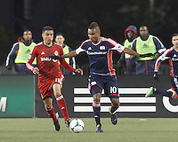 New England Revolution midfielder Juan Agudelo (10) dribbles as Toronto FC forward Luis Silva (11) closes. In a Major League Soccer (MLS) match, the New England Revolution (blue) defeated Toronto FC (red), 2-0, at Gillette Stadium on May 25, 2013.