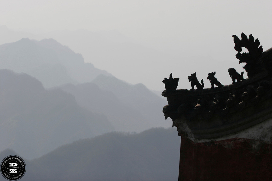 The decorated roof of one of the Taoist monasteries located in the WuDang Shan mountains in Hubei Provence in China.  Photograph by Douglas ZImmerman