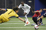 15 July 2007: Nigeria's Bello Kofarmata (7) shoots wide against Chile goalkeeper Cristopher Toselli (1). Chile's Under-20 Men's National Team defeated Nigeria's Under-20 Men's National Team 4-0 after extra time in a  quarterfinal match at Olympic Stadium in Montreal, Quebec, Canada during the FIFA U-20 World Cup Canada 2007 tournament.
