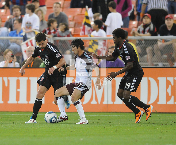 Colorado Rapids defender Kosuke Kimura (27) shields the ball against DC United midfielder Chris Pontius (13) left and midfeilder Clyde Simms (19) right   DC United tied The Colorado Rapids 1-1, at RFK Stadium, Saturday  May 14, 2011.