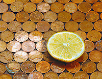 LEMON REMOVES TARNISH FROM COPPER PENNIES<br /> (2 of 2)<br /> Citric Acid and Copper Oxide<br /> A circle of shiny pennies is created by the reaction between citric acid of the lemon &amp; the copper tarnish.