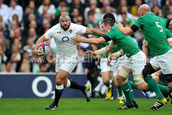 Joe Marler of England takes on the Ireland defence. QBE International match between England and Ireland on September 5, 2015 at Twickenham Stadium in London, England. Photo by: Patrick Khachfe / Onside Images