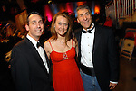 Mark and Jennifer Sondock with Mike Brasel at the Houston Rockets Tux & Tennies benefit at Toyota Center Thursday March  27,2008. (Dave Rossman/For the Chronicle)