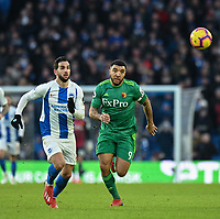 Watford's Andre Gray (right) under pressure from Brighton & Hove Albion's Martin Montoya (left) <br /> <br /> Photographer David Horton/CameraSport<br /> <br /> The Premier League - Brighton and Hove Albion v Watford - Saturday 2nd February 2019 - The Amex Stadium - Brighton<br /> <br /> World Copyright © 2019 CameraSport. All rights reserved. 43 Linden Ave. Countesthorpe. Leicester. England. LE8 5PG - Tel: +44 (0) 116 277 4147 - admin@camerasport.com - www.camerasport.com