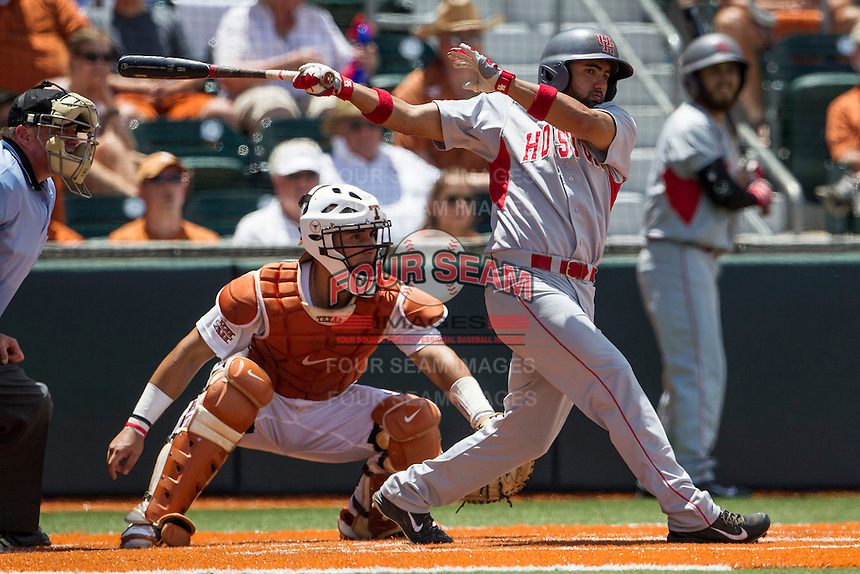 Houston Cougars shortstop Frankie Ratcliff (7) follows through on his swing during the NCAA Super Regional baseball game against the Texas Longhorns on June 7, 2014 at UFCU Disch–Falk Field in Austin, Texas. The Longhorns are headed to the College World Series after they defeated the Cougars 4-0 in Game 2 of the NCAA Super Regional. (Andrew Woolley/Four Seam Images)