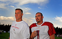 Jul 31, 2009; Flagstaff, AZ, USA; Arizona Cardinals strength and conditioning coach John Lott (left) with kicker Neil Rackers during training camp on the campus of Northern Arizona University. Mandatory Credit: Mark J. Rebilas-