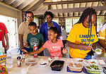 WATERBURY, CT. 13 July 2019-071319 - From left front, Donovan Degree, 8, MaKenzie Watkis, 6, and Kayla Ireland, 16, all of Waterbury makes their special ice cream sundaes, as Francisco Ramos, and NAACP Treasurer Wendy Tyson look on from behind, during the NAACP's monthly meeting and Ice Cream social at Fulton Park in Waterbury on Saturday. Bill Shettle Republican-American