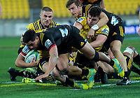 TJ Perenara tackles Anton Lienert-Brown during the Super Rugby quarterfinal match between the Hurricanes and Chiefs at Westpac Stadium in Wellington, New Zealand on Friday, 20 July 2018. Photo: Dave Lintott / lintottphoto.co.nz