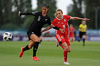 Abby Erceg of New Zealand Women's vies for possession with Kayleigh Green of Wales Women's' during the Women's International Friendly match between Wales and New Zealand at the Cardiff International Sports Stadium in Cardiff, Wales, UK. Tuesday 04 June, 2019