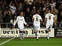 Pictured: (L-R) Jordi Gomez, Ferrie Bodde and Darren Pratley of Swansea City<br />