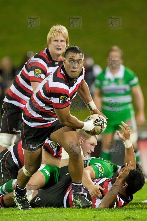 Samisoni Fisilau runs from a ruck as Captain Jamie Chipman watches. ITM Cup Championship Division Round 2 rugby game between Counties Manukau Steelers and Manawatu, played at Bayer Growers Stadium Pukekohe, on Wednesday July 20th 2011. Counties Manukau won the game 32 - 25 after leading 19 - 18 at halftime.