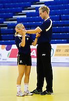 11 JUN 2010 - LONDON, GBR - British physiotherapist Lauren Bradshaw checks goalkeeper Jesper Parkers arm during the warmup before the teams match against Estonia in their 2012 European Handball Championships Qualification Tournament.(PHOTO (C) NIGEL FARROW)
