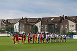 The two teams shaking hands at the Mersey Travel Arena, home to Marine Football Club (in white), pictured before they played host to Ilkeston FC in a Northern Premier League premier division match. The match was won by the home side by 3 goals to 1 and was watched by a crowd of 398. Marine are baed in Crosby, Merseyside and have played at Rossett Park (now the Mersey Travel Arena)  since 1903, the club having been formed in 1894.