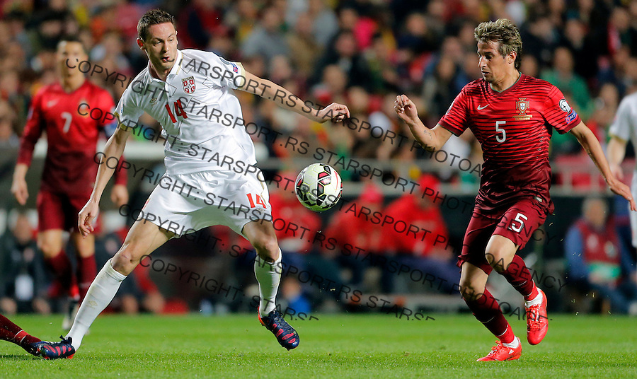 Nemanja Matic Fabio Coentrao Uefa EURO 2016 qualifying football match between Portugal and Serbia in Lisboa, Portugal on March 29. 2015.  (credit image & photo: Pedja Milosavljevic / STARSPORT)