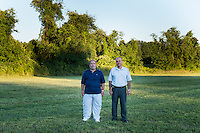 Dr. Amjad Bahnassi (left), the Chairman of the Board of the Islamic Society of Greater Worcester, and Dr. Ihab Dabbagh, former president and board member of the Islamic Society, are seen here in Dudley, Massachusetts, on Tues., Aug 23, 2016, on a plot of land that the Islamic Society is trying to buy to create a Muslim cemetery for the community. The nearest Muslim cemetery is in Enfield, Connecticut, and many of the group's relatives are buried there. The group is looking for a place closer to Worcester to bury their loved ones but has encountered substantial opposition from locals and town officials. Dabbagh is a Syrian immigrant who came to Worcester in 1998 to open a dental practice; he now lives in nearby Shrewsbury, Mass. Bahnassi is a psychiatrist and Medical Director of Behavioral Healthcare Services and in Worcester, Massachusetts. He is a Syrian immigrant who arrived in Worcester in 1983 for a residency at the University of Massachusetts. He became an American citizen in the late 1980s. His son is buried in the Enfield, Connecticut, Muslim cemetery, and he says the distance to that cemetery makes it difficult to visit his son's gravesite as often as he would like. He believes Dudley locals' fear of and bigotry toward Muslims is driving opposition to the proposed cemetery.