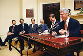 United States President Bill Clinton tapes his weekly radio address from the Roosevelt Room of the White House in Washington, DC on Friday, February 7, 1997.  The President was joined by (from right to left) US Vice President Al Gore, US Secretary of Education Richard Riley; US Senator Jay Rockefeller (Democrat of West Virginia), US Representative Ed Markey (Democrat of Massachusetts), and unidentified.  The President and Vice President spoke about the progress made in bringing 21st century technology to schools and students.<br /> Mandatory Credit: Sharon Farmer / White House via CNP