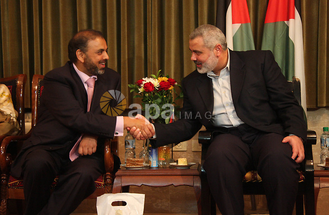 """Palestinian Prime Minister Ismail Haniyeh receive the delegation ship """"dignity"""" at his headquarters in Gaza city."""