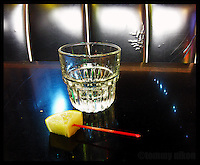 Shot of tequila with a lime slice at dive bar