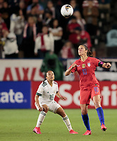 CARSON, CA - FEBRUARY 7: Carli Lloyd #10 of the United States heads a ball during a game between Mexico and USWNT at Dignity Health Sports Park on February 7, 2020 in Carson, California.