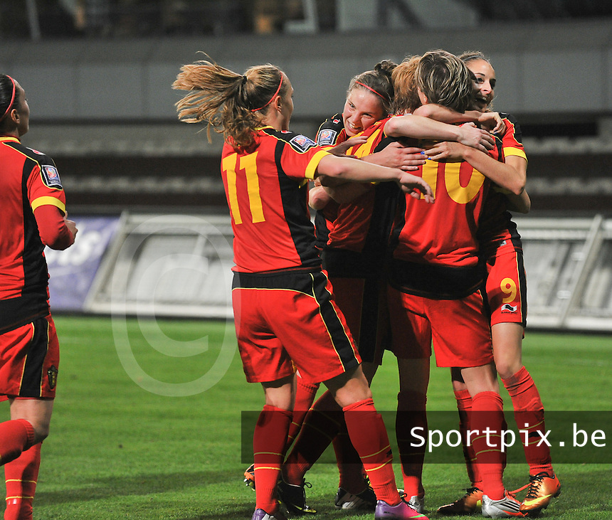 20131031 - ANTWERPEN , BELGIUM : Belgian team pictured celebrating after the 3-1 lead against Portugal with the goal from Aline Zeler (10) during the female soccer match between Belgium and Portugal , on the fourth matchday in group 5 of the UEFA qualifying round to the FIFA Women World Cup in Canada 2015 at Het Kiel stadium , Antwerp . Thursday 31st October 2013. PHOTO DAVID CATRY