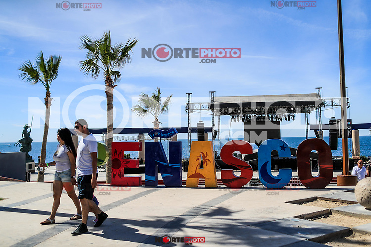 Letters of various colors with the word Penasco in the tourist destination called Puerto Penasco, Sonora, Mexico. laza or malecon of the tourist destination called Puerto Peñasco, Sonora, Mexico. plameras and blue sky. sunny day<br />