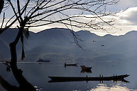 CHINA Yunnan boats at Lugu Lake / CHINA Provinz Yunnan , Boote auf dem  Lugu See