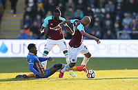 Shrewsbury Town's Aristote Nsiala challenges West Ham United's Cheikhou Kouyate and Andre Ayew<br /> <br /> Photographer Rob Newell/CameraSport<br /> <br /> The Emirates FA Cup Third Round - Shrewsbury Town v West Ham United - Sunday 7th January 2018 - New Meadow - Shrewsbury<br />  <br /> World Copyright &copy; 2018 CameraSport. All rights reserved. 43 Linden Ave. Countesthorpe. Leicester. England. LE8 5PG - Tel: +44 (0) 116 277 4147 - admin@camerasport.com - www.camerasport.com