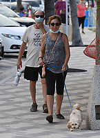 FORT LAUDERDALE, FL - JUNE 29: People are seen wearing masks while walking on Deerfield Beach boardwalk as South Florida beaches are to close for July Fourth weekend, Florida reports another record spike in coronavirus cases, Florida's Covid-19 surge shows the state's reopening plan is not working on June 29, 2020 in Deerfield Beach, Florida. Credit: mpi04/MediaPunch