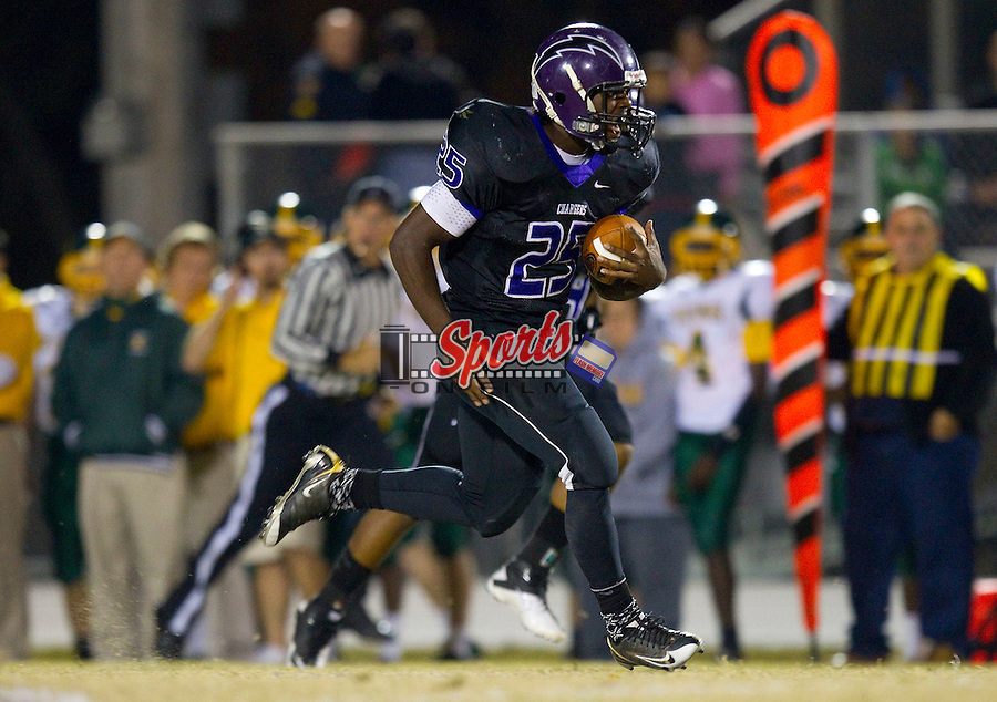 Jhaquille Hankerson (25) of the Cox Mill Chargers breaks away for a long touchdown run against the Central Cabarrus Vikings at Cox Mill High School Stadium October 29, 2010, in Concord, North Carolina.  The Chargers defeated the Vikings 48-23.  (Brian Westerholt/Sports On Film)
