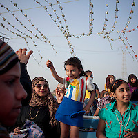 A young girl dances in a felucca (Egyptian boat) on the Nile, during the Coptic Easter. Cairo, Egypt. April 15th, 2012.