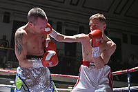 Frank Arnold (white/red shorts) defeats Russ Midgley during a Boxing Show at York Hall on 6th October 2018