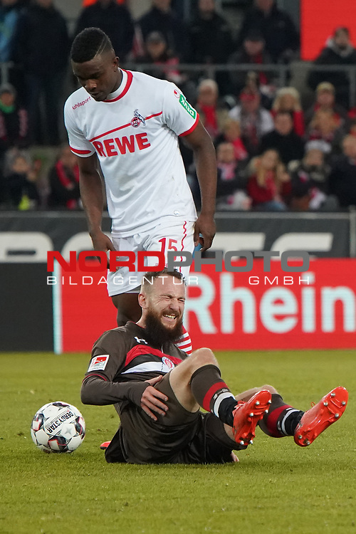 08.02.2019, RheinEnergieStadion, Koeln, GER, 2. FBL, 1.FC Koeln vs. FC St. Pauli,<br />  <br /> DFL regulations prohibit any use of photographs as image sequences and/or quasi-video<br /> <br /> im Bild / picture shows: <br /> Marvin Knoll (St Pauli #5), am Boden Jhon Córdoba (FC Koeln #15),   <br /> <br /> Foto © nordphoto / Meuter