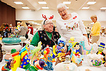 Cheryl Kurth and Irene Moore pose for a photo inside of the the annual Arts and Crafts Festival where 37 Sun City clubs sold their wares to more than 16,000 shoppers over three days in Sun City, Arizona November 30, 2013.