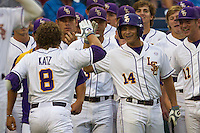 LSU Tiger third baseman Christian Iberra (14) greets teammate Mason Katz (8) after he homered during Game 4 of the 2013 Men's College World Series against the UCLA Bruins on June 16, 2013 at TD Ameritrade Park in Omaha, Nebraska. UCLA defeated LSU 2-1. (Andrew Woolley/Four Seam Images)
