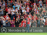 James Whaley, who fundraised for treatment for Demi Knight, who passed away this week, acknowledges the Lincoln City fans<br /> <br /> Photographer Chris Vaughan/CameraSport<br /> <br /> The EFL Sky Bet League One - Lincoln City v Bristol Rovers - Saturday 14th September 2019 - Sincil Bank - Lincoln<br /> <br /> World Copyright © 2019 CameraSport. All rights reserved. 43 Linden Ave. Countesthorpe. Leicester. England. LE8 5PG - Tel: +44 (0) 116 277 4147 - admin@camerasport.com - www.camerasport.com