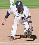 Reno Aces third baseman Tyler Bortnick makes the play on a ball down the line against the Sacramento River Cats during their game played on Sunday afternoon, September 9, 2012 in Reno, Nevada.