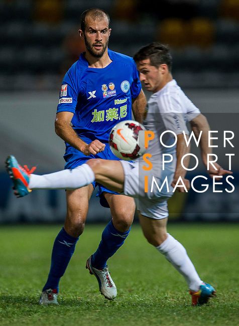 (R) Pablo Piatti of Valencia CF competes for the ball  (L) Ivan Moya of BC Ranger FC during LFP World Challenge 2014 between Valencia CF vs BC Rangers FC on May 28, 2014 at the Mongkok Stadium in Hong Kong, China. Photo by Victor Fraile / Power Sport Images