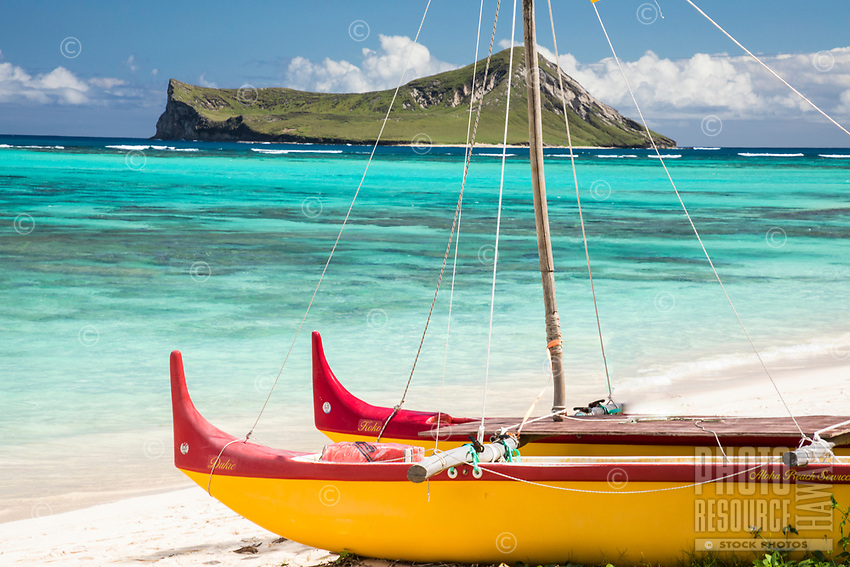 An outrigger canoe at Waimanalo Beach, with Manana (or Rabbit) Island in the distance, Windward O'ahu.