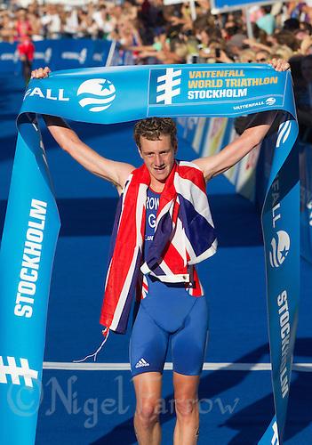 25 AUG 2013 - STOCKHOLM, SWE - Alistair Brownlee (GBR) of Great Britain celebrates winning the men's ITU 2013 World Triathlon Series round in Gamla Stan, Stockholm, Sweden (PHOTO COPYRIGHT © 2013 NIGEL FARROW, ALL RIGHTS RESERVED)