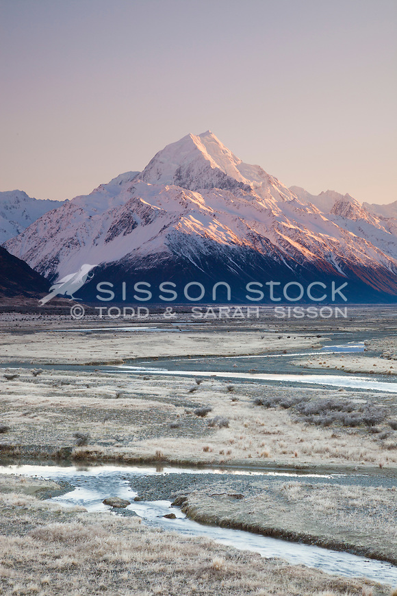 Winter sunrise looking up the Tasman Valley towards Aoraki / Mt Cook covered in snow, Mackenzie Country, Canterbury, New Zealand