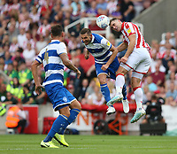 Stoke City's Sam Vokes battles with Queens Park Rangers' Angel Rangel <br /> <br /> Photographer Stephen White/CameraSport<br /> <br /> The EFL Sky Bet Championship - Stoke City v Queens Park Rangers - Saturday 3rd August 2019 - bet365 Stadium - Stoke-on-Trent<br /> <br /> World Copyright © 2019 CameraSport. All rights reserved. 43 Linden Ave. Countesthorpe. Leicester. England. LE8 5PG - Tel: +44 (0) 116 277 4147 - admin@camerasport.com - www.camerasport.com