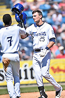 Asheville Tourists right fielder Sam Hilliard (25) is greeted at home after hitting a home run during a game against the Rome Braves at McCormick Field on April 17, 2016 in Asheville, North Carolina. The Tourists defeated the Braves 12-5. (Tony Farlow/Four Seam Images)