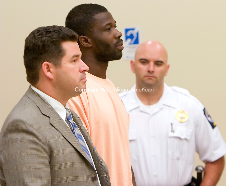 WATERBURY, CT. 25 July 2008-072508SV02--Public Defender Wayne Jekot stands with Michael Brawly, 24, of Waterbury in Superior Court during arraignment in Waterbury Friday. Brawly was charged in a home invasion in Naugatuck Thursday.  Steven Valenti Republican-American
