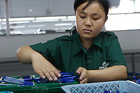 Workers in the China's Faber-Castell factory in Guangzhou, China. Faber-Castell is a German manufacturer of writing instruments. It now has factories at 16 sites worldwide, including Peru, Indonesia, India and China, and makes 2 billion pencils a year..